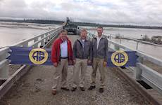 "Hanson's President and CEO Sergio ""Satch"" Pecori, P.E.; Vice President and Project Manager Mathew Fletcher, P.E., S.E.; and Vice President and Project Manager Michael Pochop, P.E., celebrate the Tanana River Bridge opening on Aug. 5, 2014."