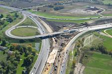 The previous interchange had a trumpet-type design with a tight loop ramp connecting northbound I-39 with westbound I-90.