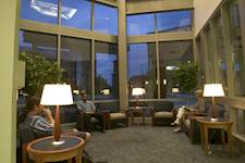 Students relax in a comfortable seating area located near University Hall's main lobby.