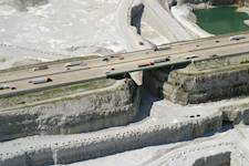 Traffic proceeds over the south side of the Thornton Quarry Bridge, overlapping the 400-foot-deep rock quarry.