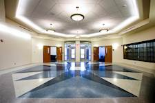 The terrazzo flooring for the main lobby adds interest and functions as a way-finding tool, providing visual cues to building users through the corridors.