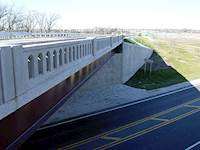 The project team also implemented aesthetic improvements including landscaping and rustication of concrete faces, decorative bridge rail and fencing.