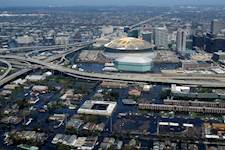 An aerial view from a U.S. Navy helicopter shows the rising flood waters threatening the entire downtown New Orleans city center, including the famed New Orleans Saints Super Dome.  Image courtesy of the U.S. Navy.