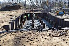 A construction crew works on the site of a tower foundation after the seal coat concrete has been poured. Hanson developed individual foundation designs for each of the five tower sites.