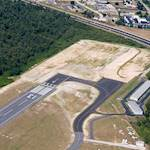Because of considerable growth, the airport needed to extend a runway.