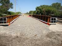 Hanson also provided construction management services for the project, proactively managing critical path activities, including the reconstruction of 10 railroad bridges and more than 1.3 miles of trackbed grading.