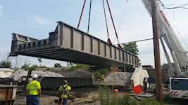 The bridge superstructure was replaced with a 70-foot-long, welded-steel, through-plate girder with a ballasted steel deck.