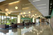 The open, airy and inviting lobby in Juniper-Poplar Hall serves as a gateway to USF students, providing access to housing suites, living/learning centers, study areas and much more.