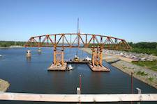 This project featured float-in construction for the railroad-truss main span to minimize obstruction to the Tennessee River's navigation.