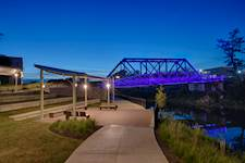 Hanson's structural engineers worked closely with a geotechnical subconsultant to design solutions for building on the unsuitable soils surrounding the creek, including using helical piles, or driven H-piles, to support three elevated bridges.
