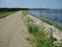 While some of the roadway sections act as dams, they were not originally designed to function as long-term dams or safely impound water.