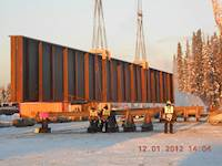 A major challenge of this project was transporting by truck 80 165-foot-long girders 330 miles on Alaskan roads.